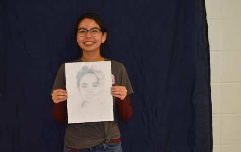 Visual Arts II students with their self-portraits