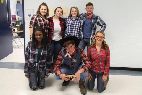Western: Ashley Warren, Nathan Rundle, Haley Riggs, Samantha Collins, Kayla Pence, Mackenzie Griffie, and Quenten Briggs show off their finest Western attire.