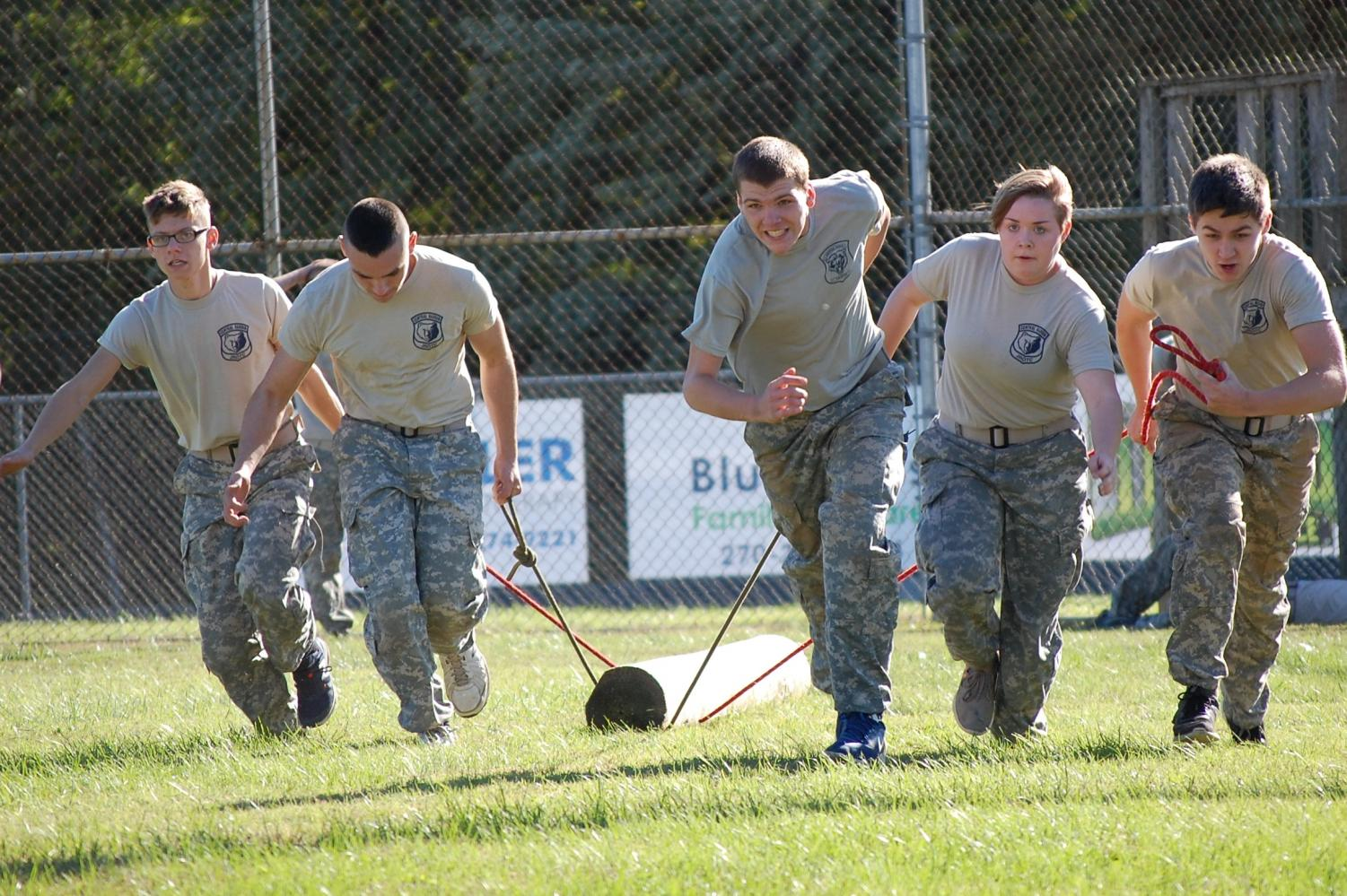 Courtesy of Roland Haun Bruin Raider Team members (l-r) Matthew Yates, Cole Vinton, Timothy Newton, Halli Hardesty, and Luke Nipper demonstrate teamwork in Log Pull. The team repeated as champions at the Ohio County Raider Meet by finishing over 2 minutes ahead of the next team.