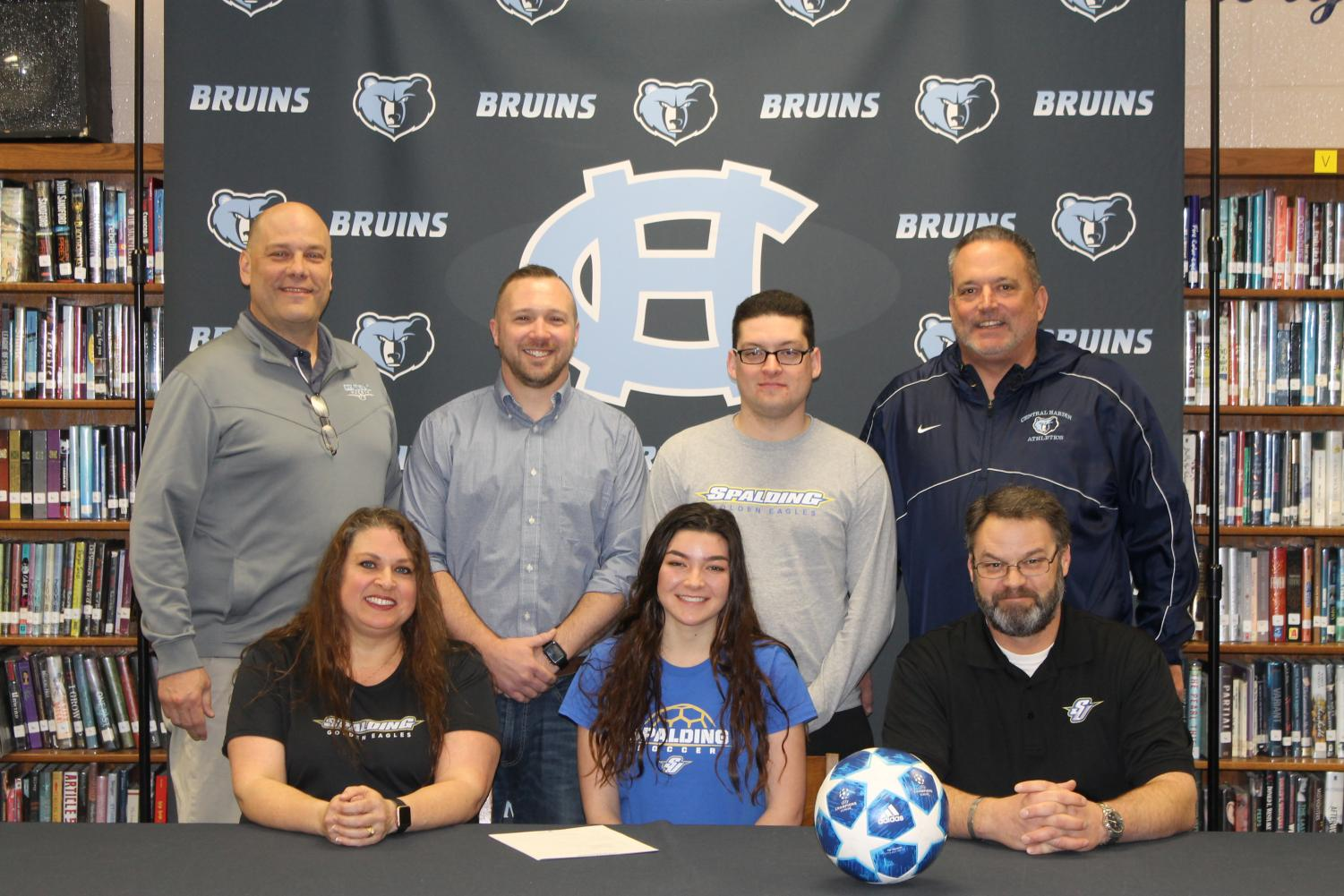 Senior+Victoria+Schmit+signs+with+the+Spalding+University+soccer+program+on+Feb.+22.