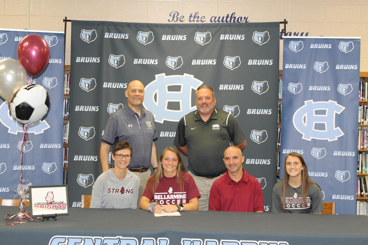 Brentyn+Dodd+signs+with+Bellarmine+University+Soccer+on+April+11%2C+supported+by+principal+Tim+Isaacs%2C+athletic+director+J.C.+Wright%2C+and+her+parents+and+sister.