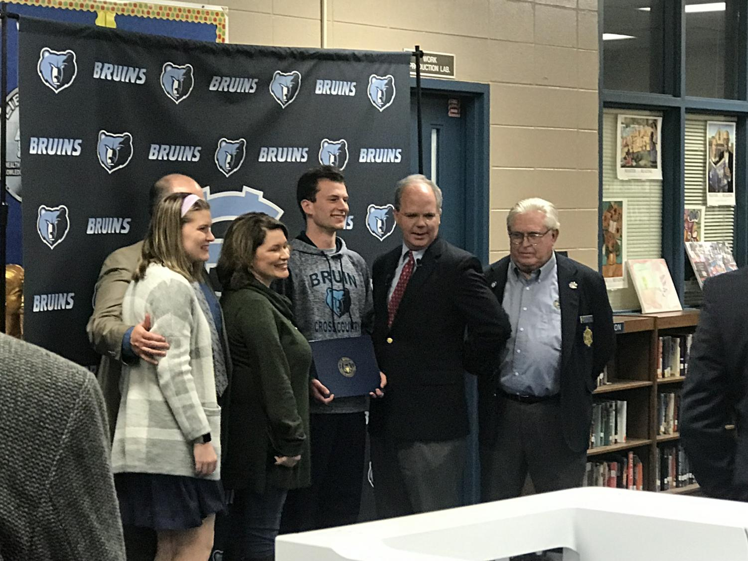 Jackson with his family, Bret Guthrie, and a naval academy representative.