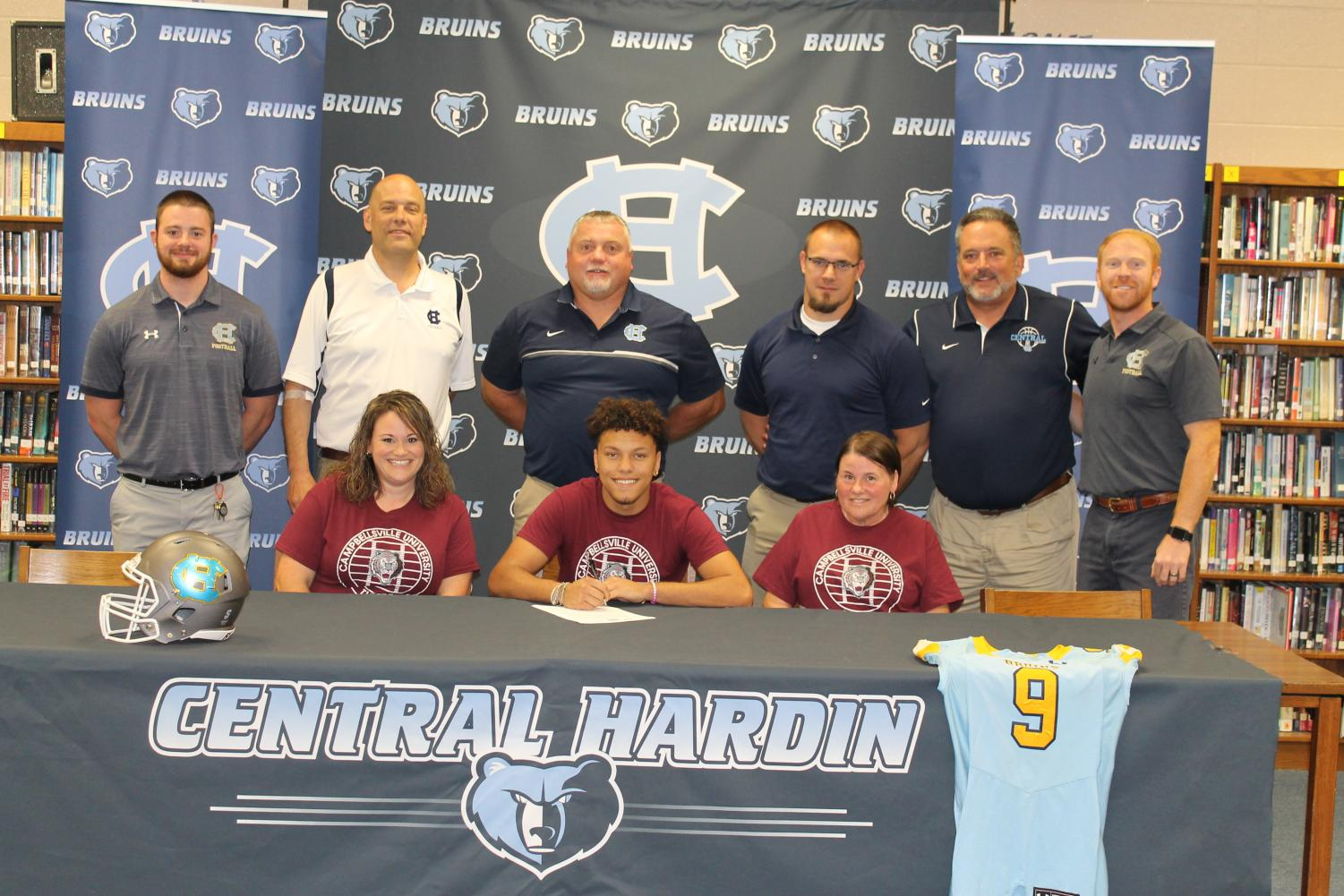 Taylon+Farris+signed+with+the+football+program+at+Campbellsville+University%2C+surrounded+by+family+and+coaches%2C+on+May+23.