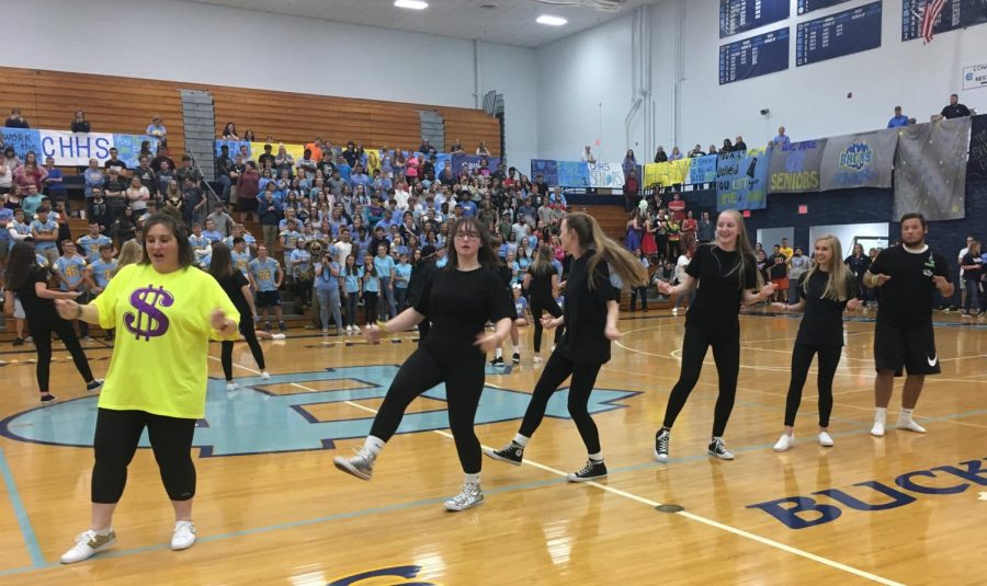 Business teacher Tiffany Spratt. T-money, and some students performed some dances at the Homecoming pep rally.