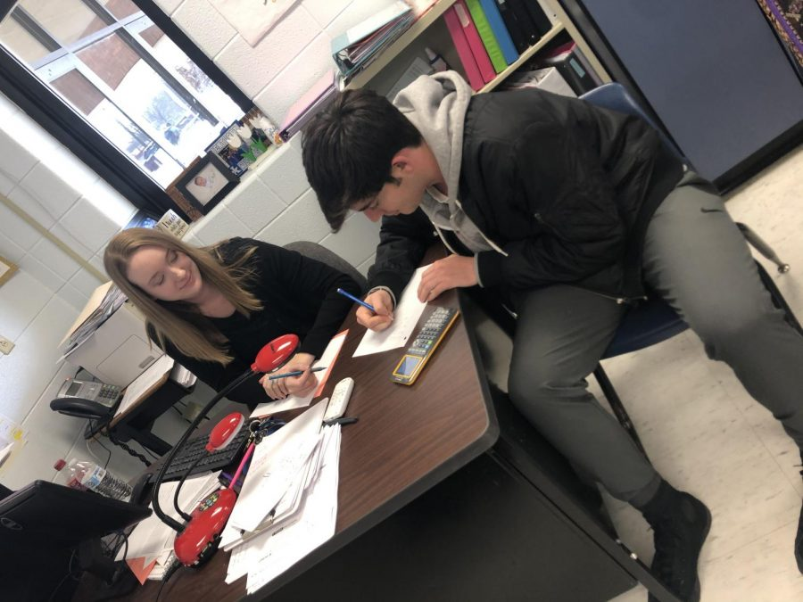Ms. Dougherty helping out a student during PowerHour.