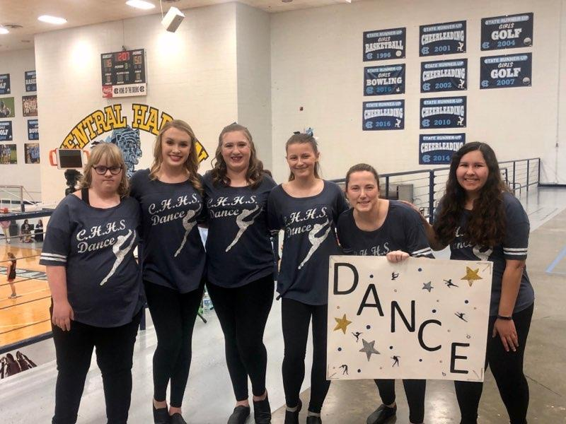 The Central Hardin Dance Team (From left to right: Jessica Hardy, Reaghan Scarborough, Alyssa Vittitow, Rhiannon Goodman, Brooke Jensen-coach, and Maegan Harlan-assistant coach) stands proud with their coaches, ready to preform.