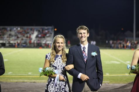 2019 graduate Tatum Cox with her older brother Trevin in the 2016 football Homecoming ceremony.