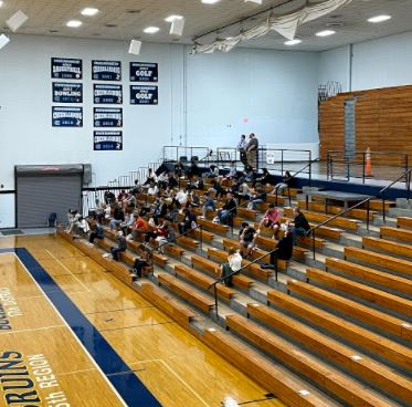 Group B students on March 30 prepare for eating lunch in the big gym when the entire student body returns together on April 12. Lunch will be held in the big gym since proper social distancing without masks cannot occur in  most classrooms.