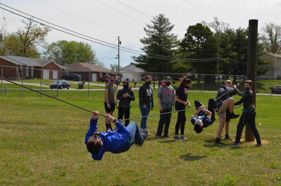 JROTC class practices drills pulling themselves across wire. (April 13)