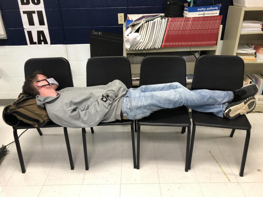 Senior Trevor Hardy lies down during the last five minutes of 2nd block after a tiring week and a half of five day instruction. ( April 21)