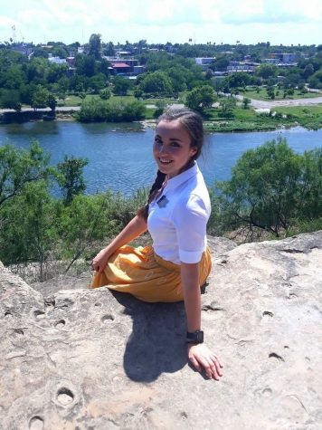 CHHS alumna, Annalese Tilley sitting in front of the Rio Grande.   Photo courtesy of Annalese Tilley