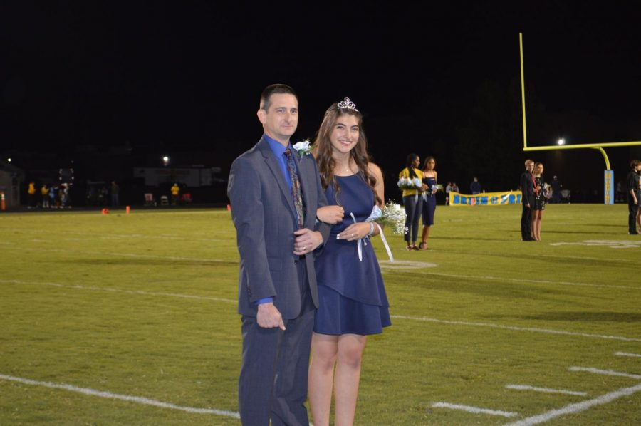 Senior Homecoming Queen Natalie Williams and her dad, Tim Williams.