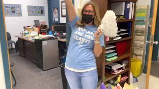 Registrar Katy Gardner performs her Friday Fight Song hype.